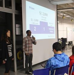 GSL-Peru students April Baker of MIT Sloan (left) and Dalitso Banda of EECS give a talk at Universidad de Ingeniería y Tecnología (UTEC).