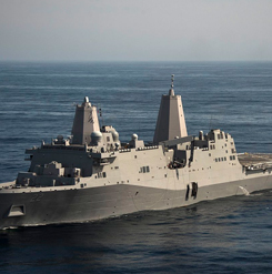 The U.S. Navy amphibious transport dock ship USS San Diego (LPD-22) underway conducting an underway recovery test for NASA's Orion crew module.
