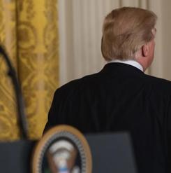 Trump leaves the room