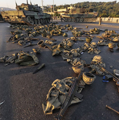 Clothes and weapons belonging to soldiers involved in the coup attempt that have now surrendered lie on the ground abandoned on Bosphorus Bridge on July 16, 2016, Istanbul, Turkey. (Gokhan Tan/Getty Images)