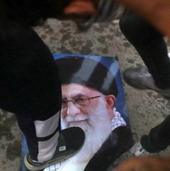 Protesters trample a portrait of Iran's supreme Leader Ayatollah Ali Khamenei during the storming and burning of the Iranian consulate in Basra, southeast of Baghdad, last week. (Nabil al-Jurani/AP)