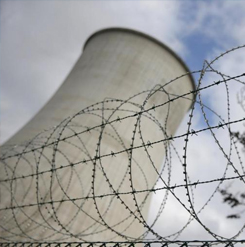 Barbed wire is pictured at the entrance of the Tihange nuclear power station, one of the two large-scale nuclear power plants in Belgium, in this March 26, 2016 file photo. REUTERS/Vincent Kessler