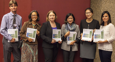 Members of the delegation deliver mercury science policy briefs, developed by the 13th annual International Conference on Mercury as a Global Pollutant (ICMGP), to Minamata delegates.