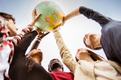 students holding up a globe