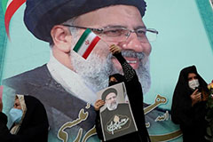 A supporter of Ebrahim Raisi displays his portrait during a celebratory rally for his presidential election victory in Tehran, Iran, June 19, 2021 Photo by Majid Asgaripour/West Asia News Agency via Reuters