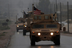 U.S. military vehicles in Syria's northern city of Manbij on Dec. 30. (Delil Souleiman/AFP)