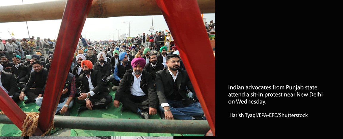 Indian advocates from Punjab state attend a sit-in protest near New Delhi on Wednesday.
