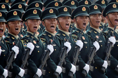 Soldiers march in formation past Tiananmen Square on Oct. 1 during the military parade marking the 70th anniversary of the founding of the People's Republic of China. (Jason Lee/Reuters)