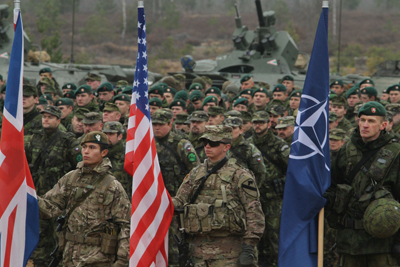 Soldiers holding US flag and NATO flag