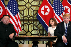 North Korean leader Kim Jong Un and U.S. President Donald Trump listen to questions from the media during their one-on-one bilateral meeting at the second North Korean-U.S. summit in the Metropole hotel in Hanoi, Vietnam, February 2019.