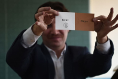 "A Turkish electoral official shows a ""Yes"" vote as ballots are counted in the referendum on expanding the powers of the president on April 16, 2017 in Istanbul. (Ozan Kose/Agence-France Presse via Getty Images)"