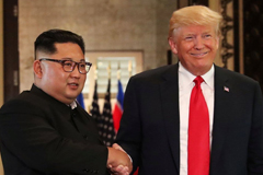 President Trump and North Korean leader Kim Jong Un shake hands on June 12 following their summit in Singapore. (Jonathan Ernst/Reuters)