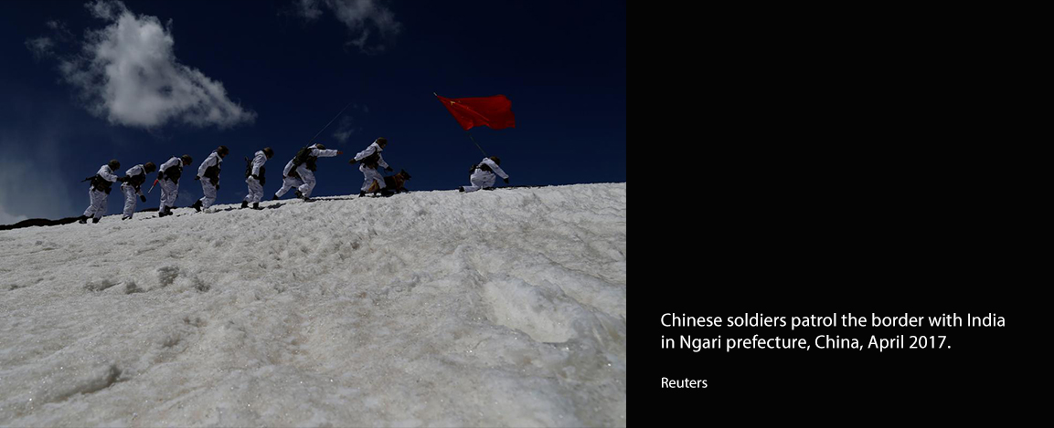 Chinese soldiers patrol the border with India