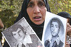 Iraqi woman holding archival photos