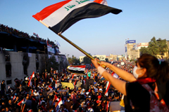 A protester waves an Iraqi flag during an anti-government demonstration in Baghdad on Nov. 1, 2019. (Ahmed Jadallah/Reuters)