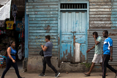 African migrants walk in the streets of Tapachula, heading to the central park. The arrival of African and other migrants is changing the demographics of this Mexican town. Enncarni Pindado