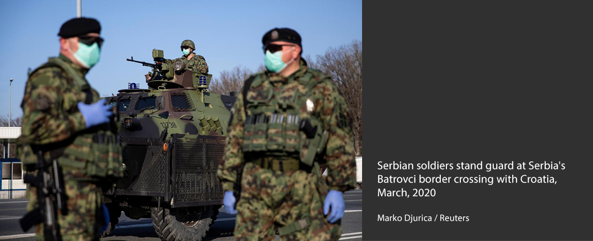 Serbian soldiers stand guard at border crossing with Croatia
