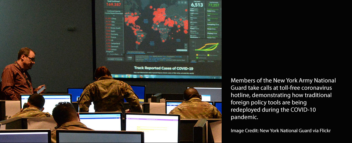 Members of New York National Guard take calls on a hotline for pandemic