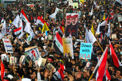Iraqi demonstrators rally to mourn Iranian general Qasem Soleimani and an Iraqi paramilitary leader a year after they were killed in a US drone strike AHMAD AL-RUBAYE