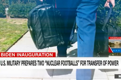 Screenshot of CNN video with person carrying the bags containing the US Nuclear Football