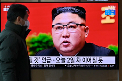 A man watches a television screen showing news footage of North Korean leader Kim Jong Un attending the 8th Congress of the ruling Workers' Party, held in Pyongyang, at a railway station in Seoul on Jan. 6. Jung Yeon-je/AFP via Getty Images