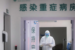 In a photo released by China's Xinhua News Agency, a medical staff member wearing a protective suit works in the department of infectious diseases at Wuhan Union Hospital on Jan. 28. (Xiao Yijiu/Xinhua/AP)