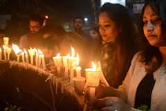 Indian mourners take part in a candle-lit vigil following the car bombing © AFP