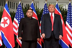 Donald Trump and Kim Jong Un pose for the cameras at their first summit on June 12, 2018 in Singapore. (Photo: AFP/SAUL LOEB) Read more at https://www.channelnewsasia.com/news/world/trump-s--great-chemistry--with-kim-jong-un-put-to-test-at-summit-11281222