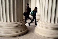 Students walked through pillars at MIT.