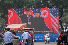 President Donald Trump and North Korean leader Kim Jong Un on a large screen, February 28, in Hanoi, Vietnam. Carl Court/Getty Images