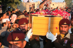Pakistani soldiers carry a coffin of Pakistani soldier Khuram Ali who reportedly lost his life during heavy shelling from Indian troops at the Line of Control in Pakistani Kashmir, during his funeral in Dera Ghazi Khan in Pakistan, Monday, March 4, 2019. (Asim Tanveer)