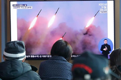 North Korea carried out another launch of projectiles on Monday, a week after a similar exercise [Ahn Young-joon/AP Photo] Koreans watching news coverage of the launch on tv.