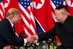 President Trump and North Korean leader Kim Jong Un shake hands at their summit in Hanoi last month. (Evan Vucci/AP)