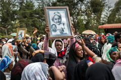 A funeral service last week for victims of a garbage landslide in Addis Ababa, Ethiopia. At least 113 people were killed in the March 11 collapse, according to the government.