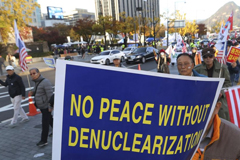 FILE - Protesters march toward the U.S. Embassy during a rally supporting the U.S. policy to put steady pressure on North Korea, in Seoul, South Korea, Nov. 3, 2018.