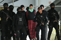 Doan Thi Huong is escorted by Malaysian police out of the high court in Shah Alam on 1 April. Photograph: AFP Contributor#AFP/AFP/Getty Images