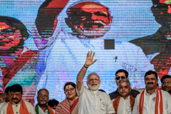 Indian Prime Minister Narendra Modi waves at the public rally in Kolkata, India, on April 3. (Atul Loke/Getty Images)
