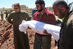 Syrians burying their loved ones after the chemical attack.