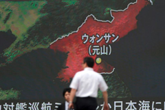 FILE - A screen shows a news program reporting in Tokyo about North Korea's missile firing from Wonsan, center, June 8, 2017.