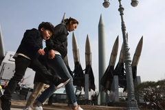 South Koreans walk past replicas of North Korean and South Korean missiles on February 28, 2019 in Seoul. North Korea tested a short-range missile on May 3, 2019. Chung Sung-Jun/Getty Images