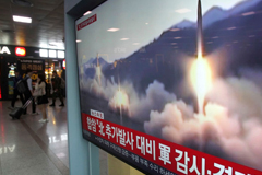 Footage of a North Korean missile launch shows on a TV screen Saturday at the Seoul Railway Station. (Ahn Young-Joon/AP)