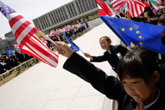 Children hold up flags from the G7 countries in the wind as the foreign ministers visit the Peace Memorial Park, on the sidelines of the G7 Foreign Ministers' Meeting in Hiroshima on April 11, 2016. Kerry and other G7 foreign ministers made the landmark visit on April 11 to the memorial site for the world's first nuclear attack in Hiroshima. (Jonathan Ernst/AFP/Getty Images)