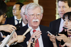 National security adviser John Bolton is surrounded by reporters at the Japanese prime minister's official residence in Tokyo on Friday. (Yohei Kanasashi/AP)
