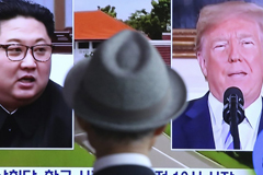 A man watches a TV screen showing file footage of U.S. President Donald Trump, right, and North Korean leader Kim Jong Un during a news program at the Seoul Railway Station in Seoul, South Korea, Monday, June 11, 2018. Final preparations are underway in Singapore for Tuesday's historic summit between President Trump and North Korean leader Kim, including a plan for the leaders to kick things off by meeting with only their translators present, a U.S. official said.