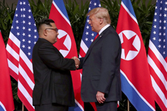 U.S. President Donald Trump shakes hands with North Korean leader Kim Jong Un at the Capella Hotel on Sentosa island in Singapore June 12, 2018.