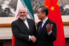 China's Foreign Minister Wang Yi (r) shakes hands with Iran's Foreign Minister Javad Zarif during a meeting in Beijing on Dec. 31, 2019. (NOEL CELIS/POOL/AFP VIA GETTY IMAGES)