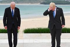 US President Joe Biden standing next to British Prime Minister Boris Johnson