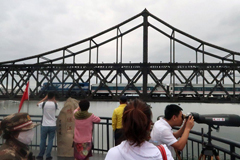 Chinese visitors in Dandong look on as a train passes from North Korea to China on the Friendship Bridge. Beijing sees Pyongyang as holding a unique place in its foreign policy. Photo: Reuters