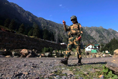 An Indian border security force soldier walks near a check post along the Srinagar-Leh National highway on Tuesday, following deadly clashes along the disputed border with China. Photograph: Anadolu Agency/Getty Images