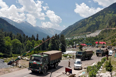 Indian army trucks move along a highway leading to Ladakh on Wednesday. (Danish Ismail/Reuters)